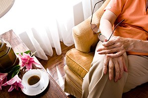 Salt Lake City senior living shows a resident relaxing with a cup of coffee