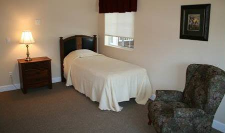 Cozy assisted living bedroom at Mesa senior living