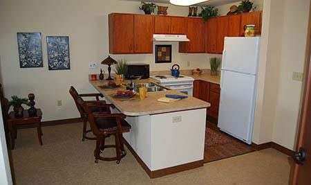 Kitchen in Apartment at Flagstone Senior Living