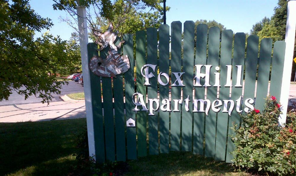 Welcome sign at Fox Hill Apartments in St. Charles