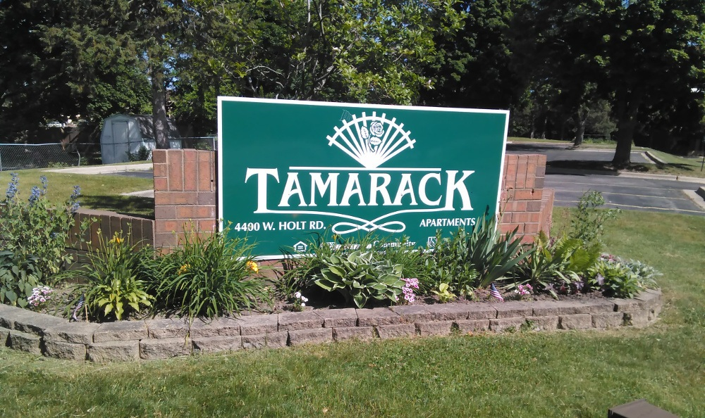 Entrance sign at Tamarack in MI , Holt