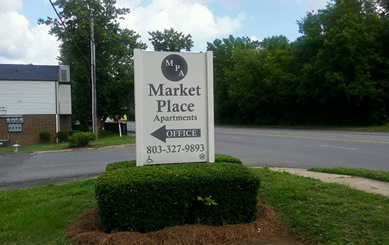 Our sign welcomes residents and their guests at Market Place.