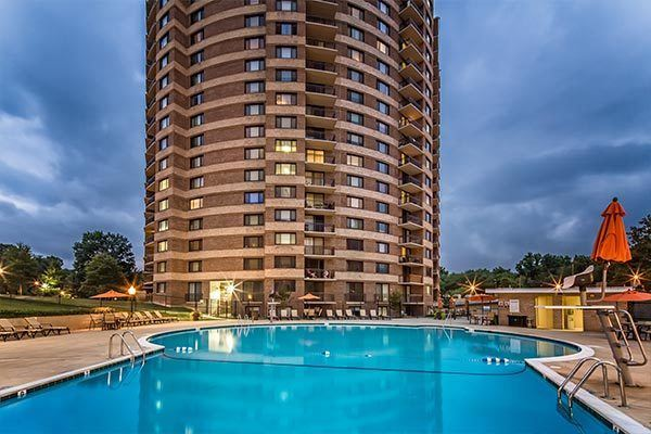 Evening pool lighting at The Warwick Apartments