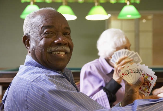 Resident playing cards at Eastlake Terrace