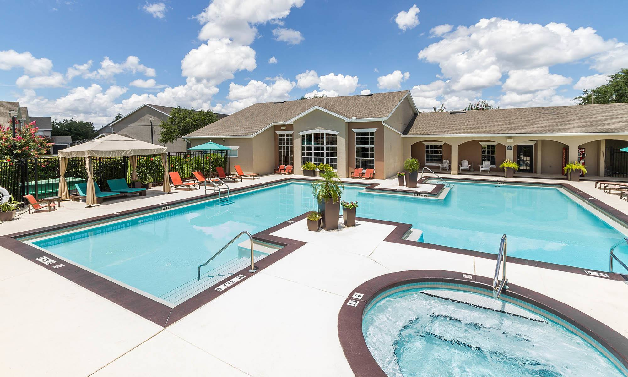 Enjoy the swimming pool at Highpoint Club Apartments in Orlando, FL