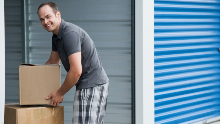 Man moving into self storage facility