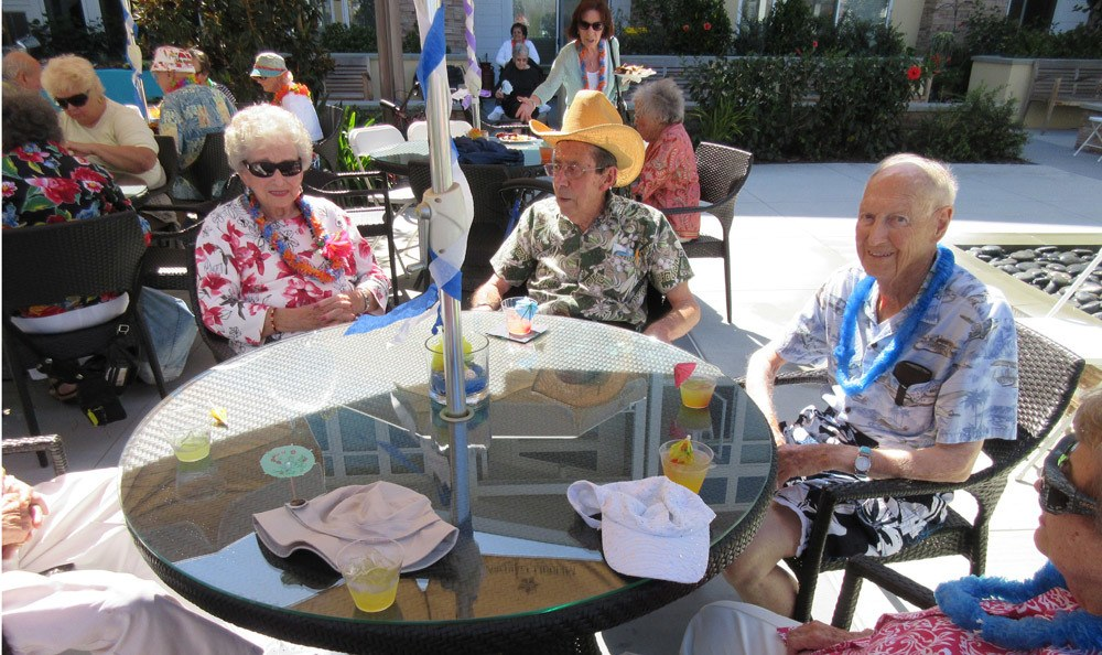 Residents Enjoying the Patio at Merrill Gardens at Huntington Beach in Huntington Beach