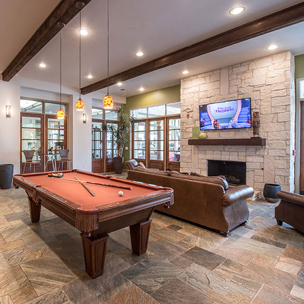 Amenities at Avana Brazos Ranch Apartments in Rosenberg include a pool table