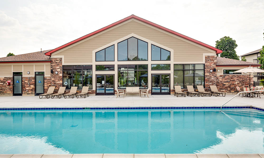 Pool and clubhouse at The Trilogy Apartments in Belleville