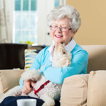 Senior woman with her dog at Aspired Living of Westmont