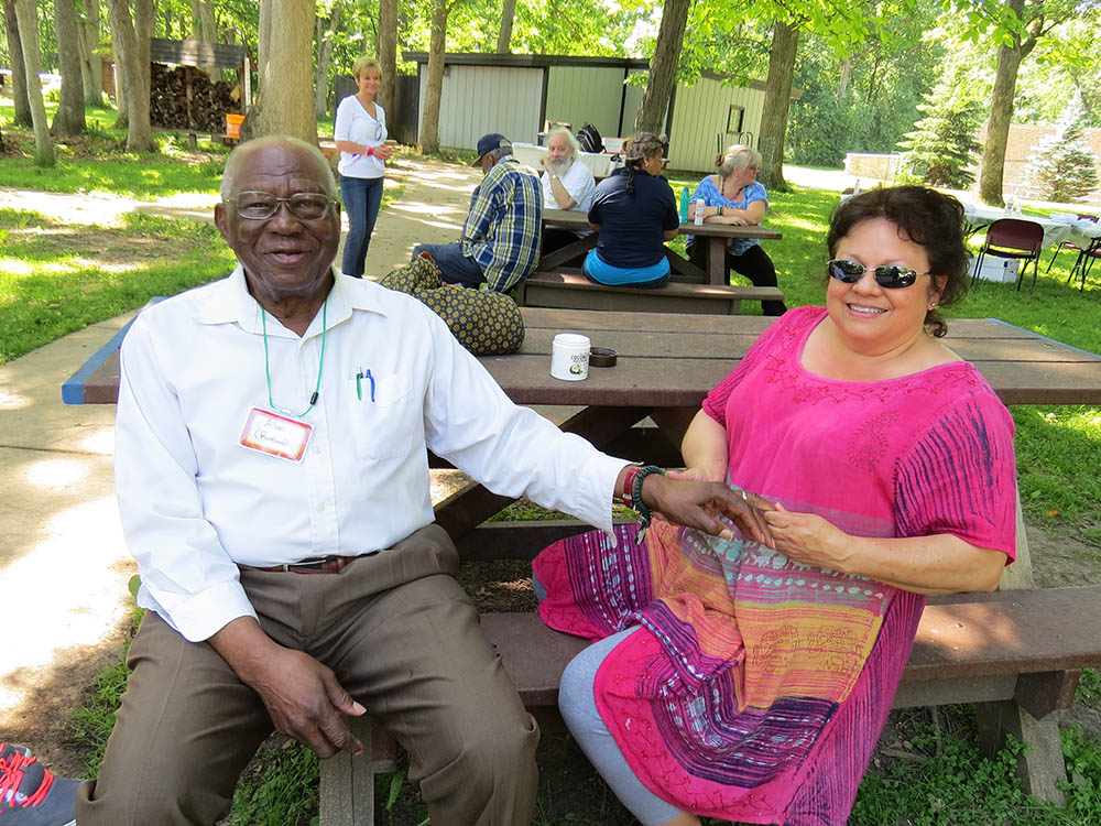 Residents enjoying a picnic outside at Victory Centre of Galewood in Chicago, IL