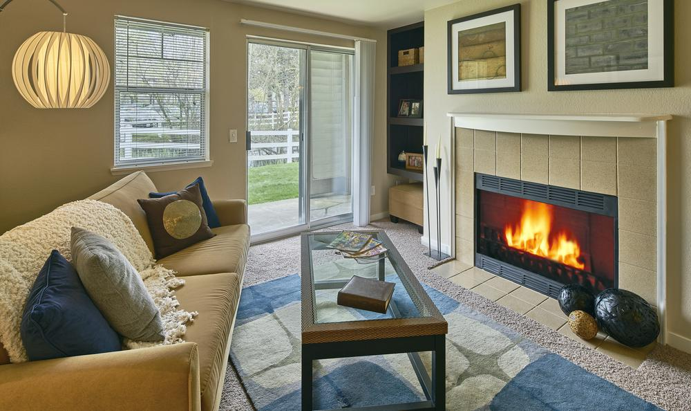 Living room with fireplace at Olin Fields Apartments
