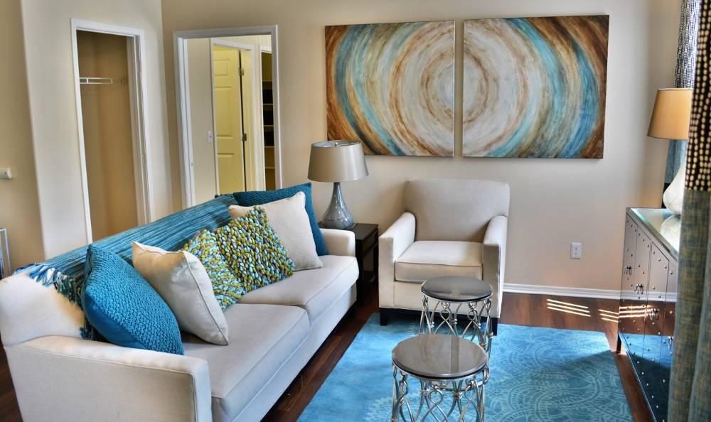 Living room in Promenade at Hunter's Glen Apartments