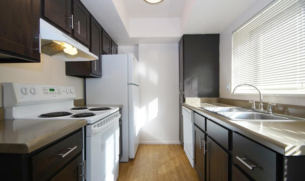 Kitchen, open floor plan at Springs of Country Woods Apartments in Midvale