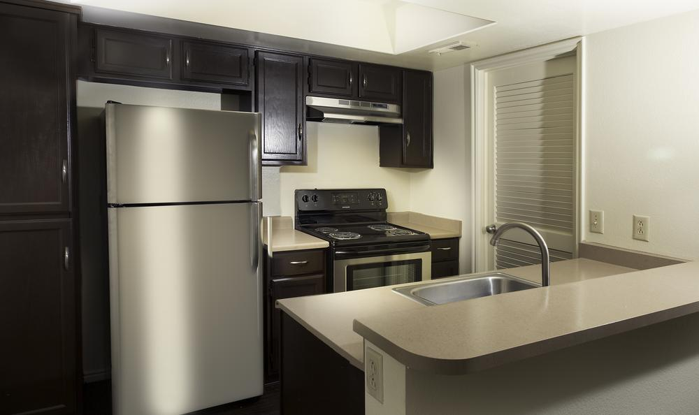 Fully Equipped Kitchen at Shadowbrook Apartments in West Valley City, UT