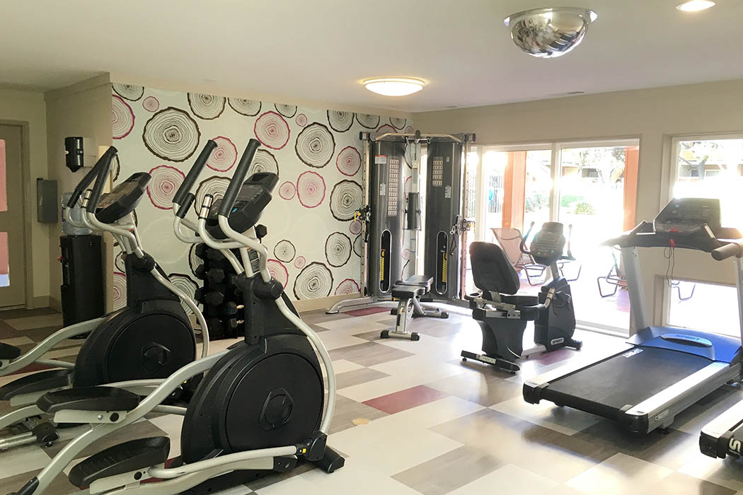 Fitness center at The Timbers Apartments in Hayward