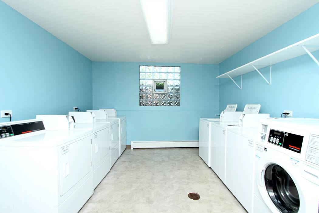 Laundry center at Westline Apartments in Hanover Park
