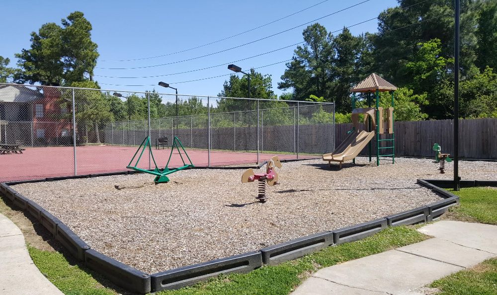 Your kids can enjoy playing in our playground at Green Tree Place Apartments