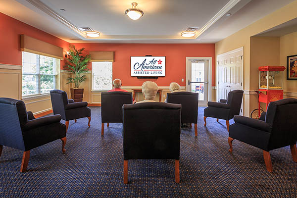 Take in a movie with friends at All American Assisted Living at Warwick