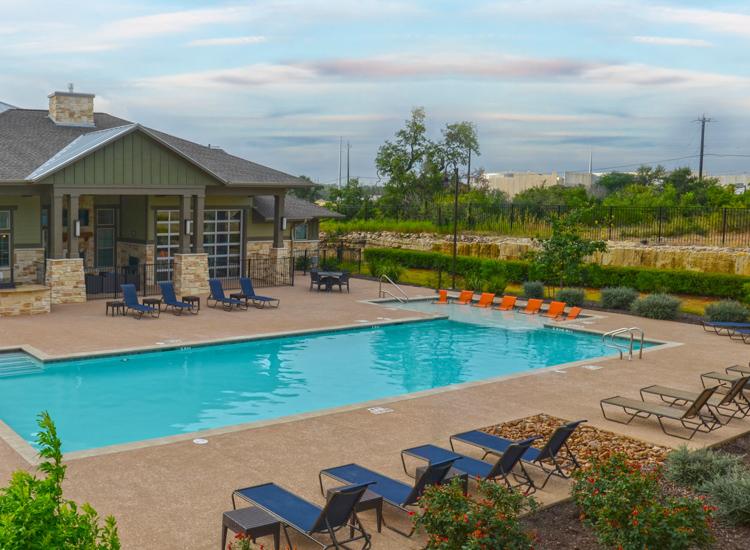 Pool shot of Springs at Alamo Ranch Apartments in San Antonio