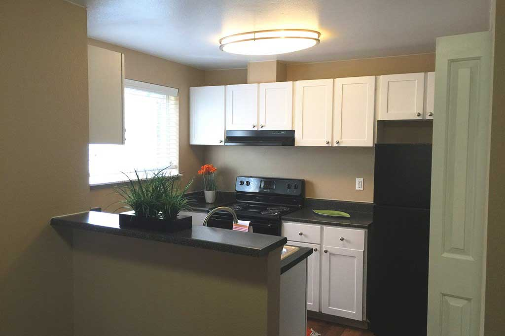 Modern kitchen in Village at Seeley Lake model home in Lakewood