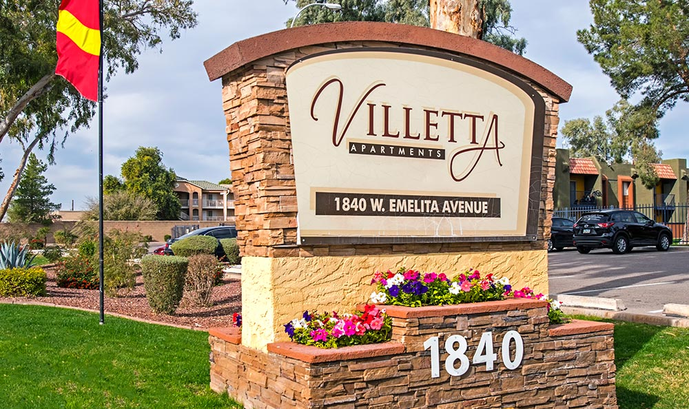Our sign at Villetta Apartments welcoming residents and guests in Mesa