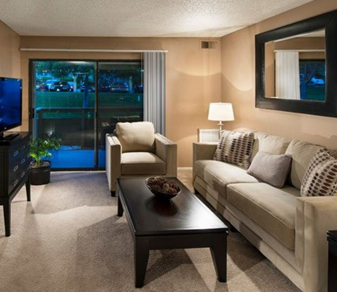 Well-decorated living room in Presidio at Rancho Del Oro model home