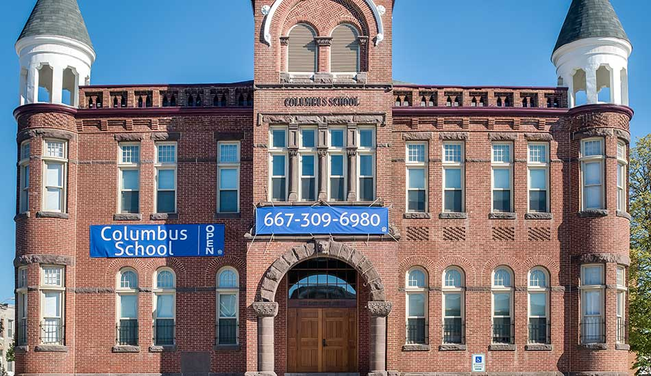 Columbus School Apartments front entrance in Baltimore