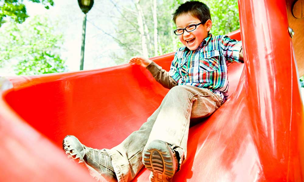 Kid on the slide at Meadowbrook Run