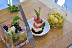 From left to right greek salad fetta cheese with melon with balsamic vinegar  mango infused shrimps