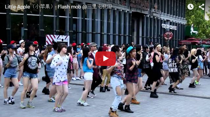 The New Chinese Craze Over The Little Apple Flash Mobs