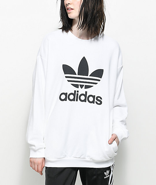 The Trefoil Oversized Crew Neck Sweatshirt offers a quality mid-weight  construction with pique knit lining for a boujee feel. Featured in white  with a black ...