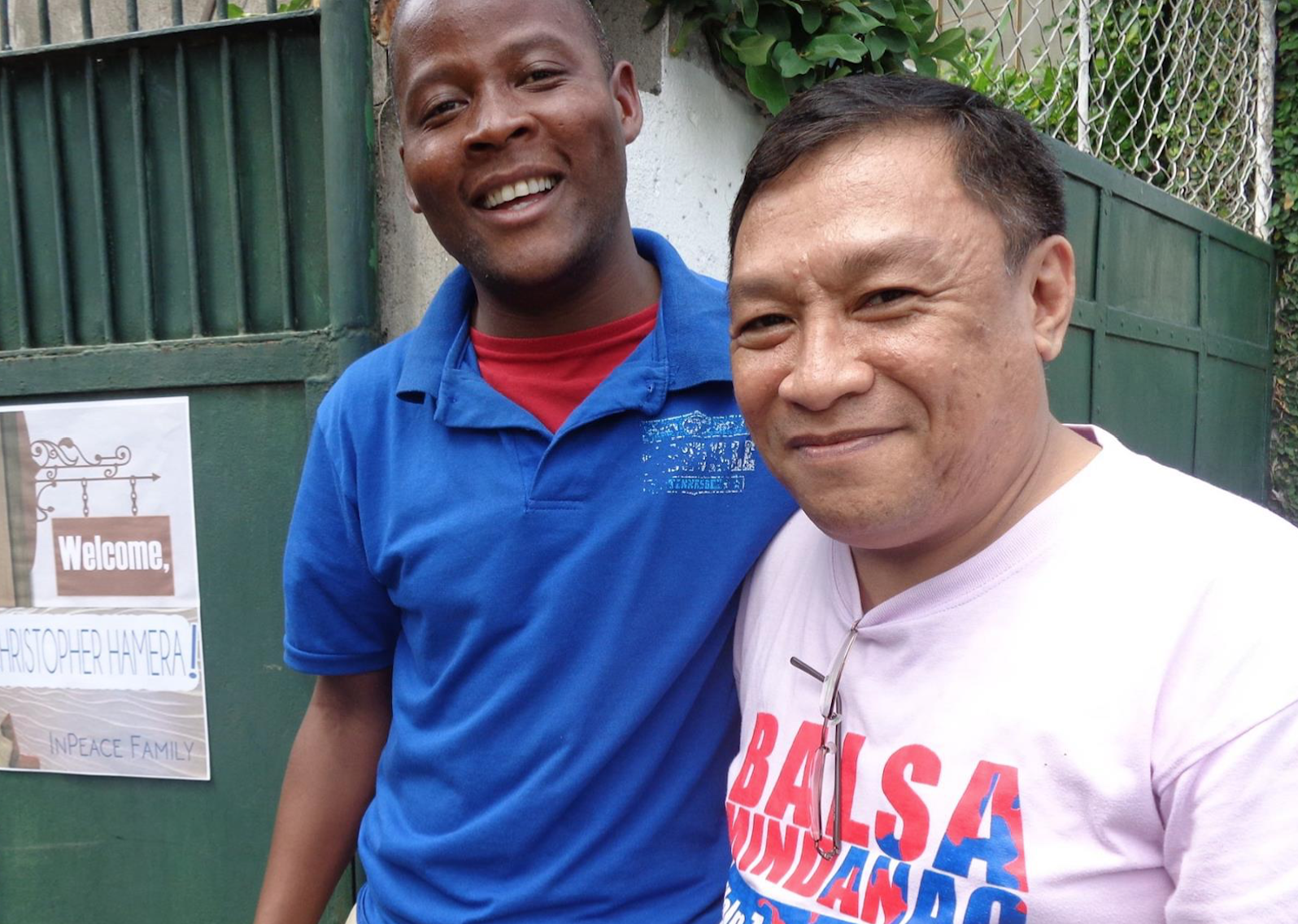 Christopher Hamera, left, welcomed by a UMC member when he arrived in Davao City, Philippines.