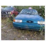 1993 green Ford Escort LX I4, 1.9L