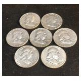 7 Franklin Half Dollar Coins