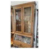 Rifle cabinet with wild bird display