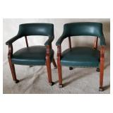 Pair of green leather arm chairs studded on