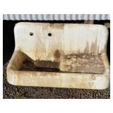 Cast iron sink with drainboard