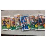 NINE SEALED FOOTBALL CARD PACKS