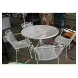WROUGHT IRON PATIO TABLE AND FOUR CHAIRS