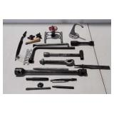 Lug wrenches chisel bits, water sprinkler, hook,