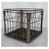 Metal Galliker Dairy crate with plastic bottom.