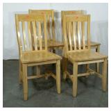 Four wood dining chairs, well worn, but sturdy.