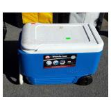 Igloo Wheeled Cooler, 38 at. Size blue color.