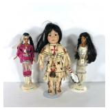 Native American dolls, two Barbies and a Buffalo