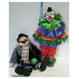Two porcelain clown dolls