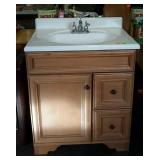Footed vanity sink cabinet, left single door with
