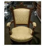 Victorian parlor chair with padded arms
