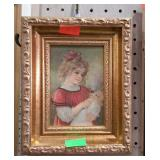 Small print of girl with doll in ornate  frame.