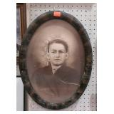 Oval frame with sepia style portrait. Picture